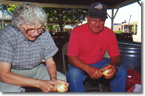 Roberta and Merle peel onions